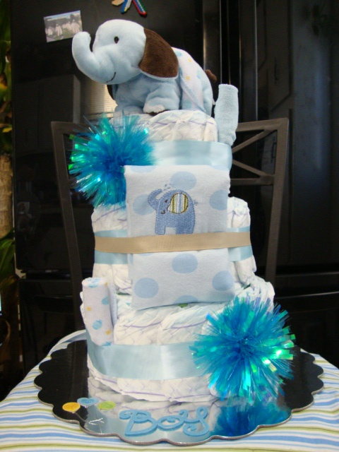 Non Edible Spiral Diaper Cakes...this one is a Baby Boy Elephant Cake...$50 Interested in a cake check out Selena's Kreation's on Facebook or Contact me @ 765-821-0805 Connersville,In.
