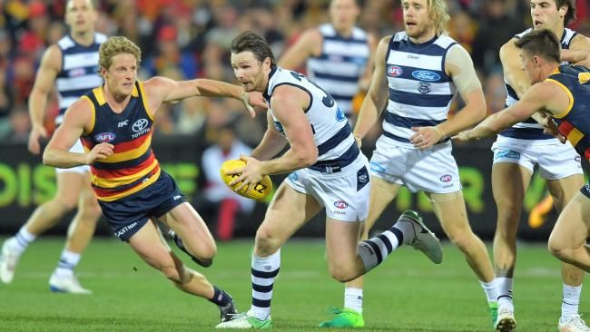 Rory Sloane, left, tussles with Patrick Dangerfield at Adelaide Oval last night.