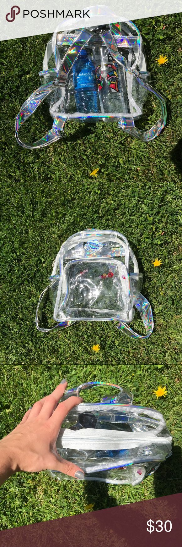 Transparent Holographic Backpack Brand new, in original packaging. Transparent Holographic Backpack. Straps are holographic faux leather. Not unif.  Tags: festival, hologram, rave, ravewear, Coachella, beyond wonderland, ultra, insomniac, dreamstate, dollskill, little black diamond, j valentine, iheartraves, edc UNIF Bags Backpacks