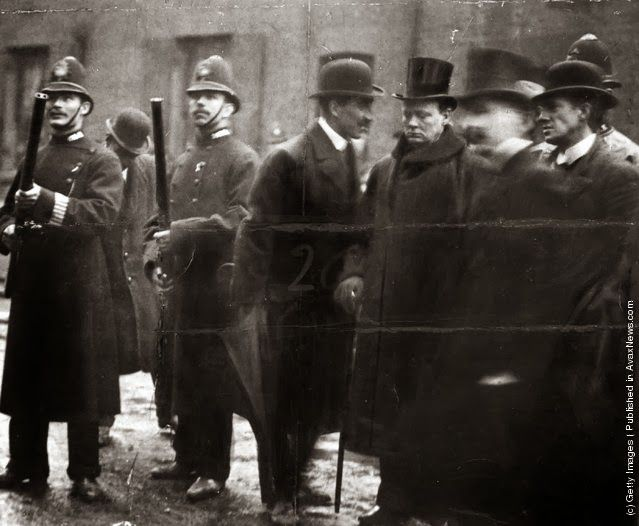 Winston Churchill (1874–1965) confers with Inspector Wensley in Sidney Street, Stepney. During the Siege of Sidney Street hundreds of heavily-armed City and Metropolitan police fought a pitched battle against two anarchists. (Photo by Victor Beveridge/Getty Images)