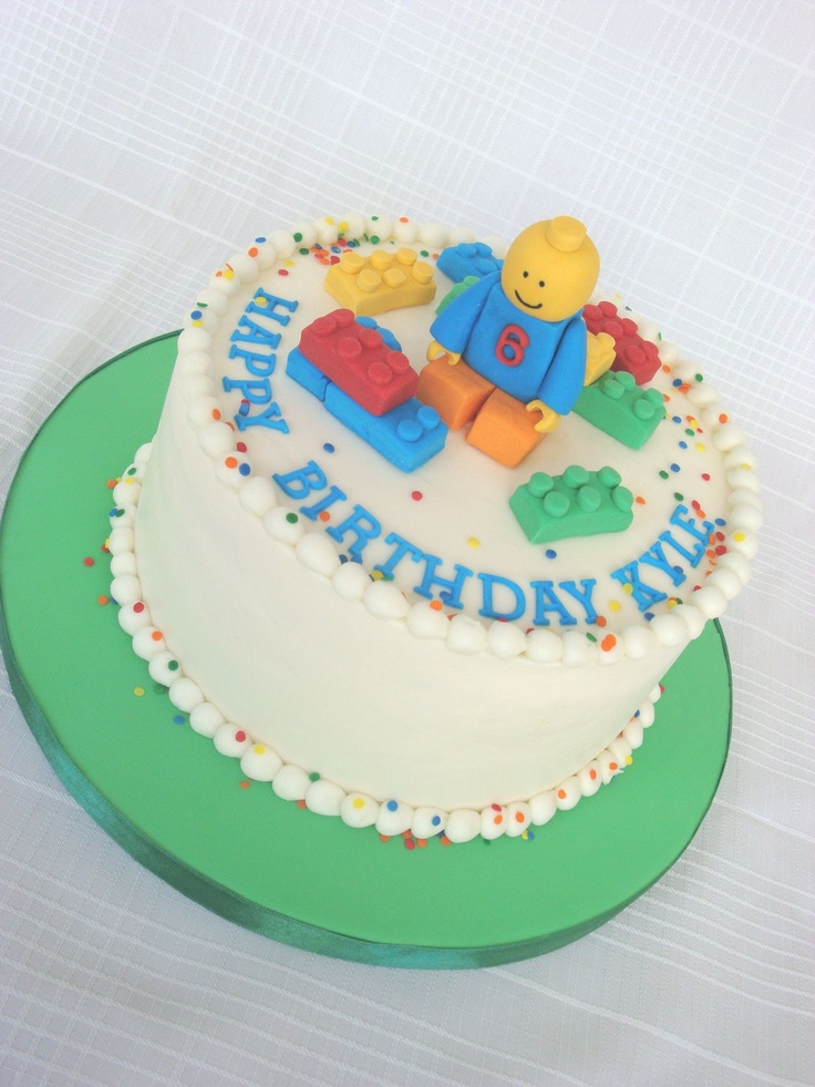 """Lego guy cake - Buttercream cake with gumpaste accents.  The customer really wanted a 3D """"lego guy"""" but in buttercream.  I told her I really would prefer to do it in fondant because I am not very good at applying BC to oddly shaped cakes.  So we decided to go with a buttercream cake with a lego guy topper instead."""