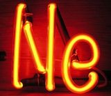 This neon filled discharge tube displays the element's characteristic reddish-orange emission.
