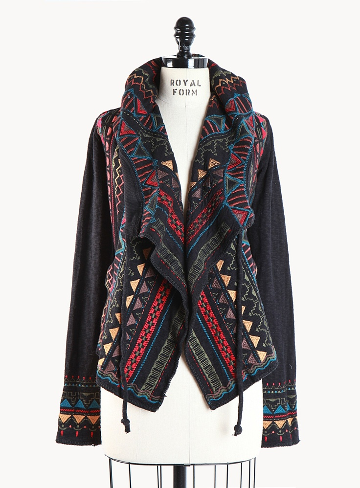 The Biya Kanji Short Hoodie is a breathtaking embroidered beauty. A tribal inspired design decorates this piece, front to back. Besides its unique design, this piece will keep you warm and cozy in the colder months. - Open draped front - Drawstring hoodie - Back tie adjustment