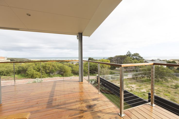 Timber deck with wire balustrade giving unobstructed views to the ocean.  For free online instant quote use our website Balustrade Builder http://www.miamistainless.com.au/balustrade-builder-start