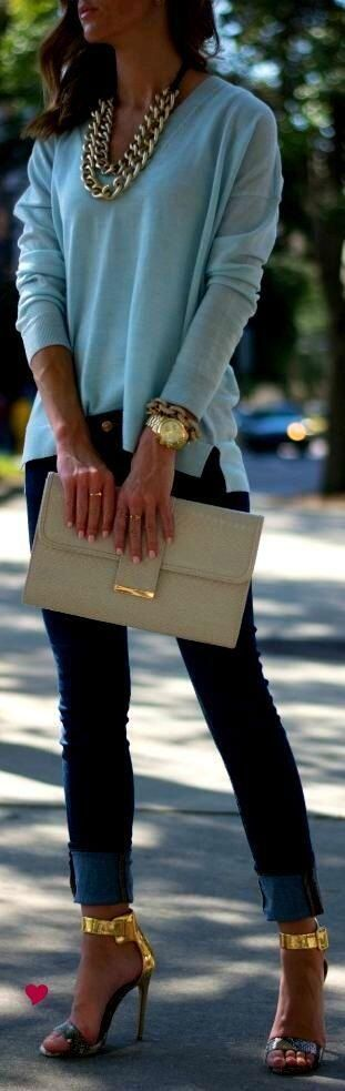 Dress up jeans and a sweater with chunky gold jewellery and heels