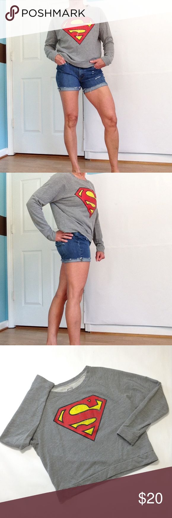 """Distressed Superman sweatshirt A loose cut, not tight at cuffs or hemline. Terrycloth lining, so could be worn in all seasons!  21"""" ↕️ from top of back neckline 21"""" ↔️ armpits 29"""" from neckline DC Comics Tops Sweatshirts & Hoodies"""