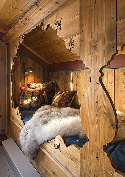 End -to-end twin beds in a rustic cut-out nook...