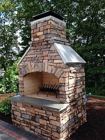 """48"""" Contractor Series Outdoor Fireplace Kit with natural stone veneer."""