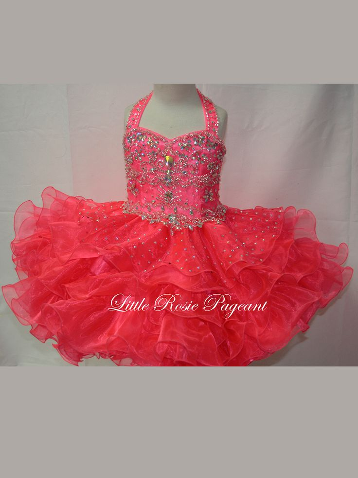 This pretty pageant dress will make your little girl look like a princess. This organza Little Rosie SR303 pageant dress features a halter neckline, gorgeous beaded bodice decorated with sparkly jewels, and a ruffled short skirt. This winning pageant dress is a great choice for your special event.