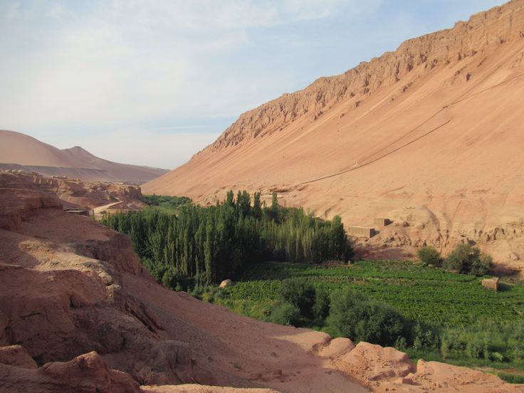 The Flaming Mountains frame the Bezeklik Thousand Buddha Caves in the Murtuk River Gorge just east of Turpan, Xinjiang, China.