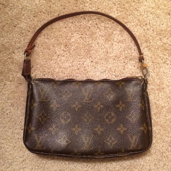 Louis Vuitton cosmetic/small handbag Authentic Louis Vuitton handbag. COMES WITH ORIGINAL DUST BAG. Traditional monogram brown canvas. Used. Lining is in good condition, but a bit dirty. No damage to the handbag, but zipper has rippled a bit, which is visible in the picture. No trades. Louis Vuitton Bags Mini Bags