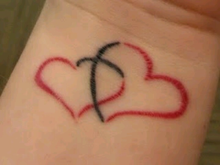 2 hearts joined together by a cross :)
