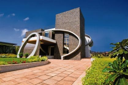 When architects Rajesh Kathe and Sohil Valia of Form, Space N Design were asked to build a vacation home for a Mumbai-based family in Lonavla, they wanted to move away from the sloping roofs that flourish in the region. Kathe's design involves a structure of three huge vaults (an arch-shaped structure) and two arches that decorate the front elevation. The design is such that none of the four sides of the structure appear uniform.