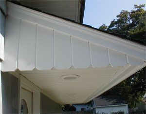 The new overhang provides shelter over the door and includes new vinyl soffits and recessed lights.  Crown Molding, Fireplace Mantles, Window and Door Trim, Wainscotting, Baseboards, Custom Cabinets, Carpenter, Finish Carpentry