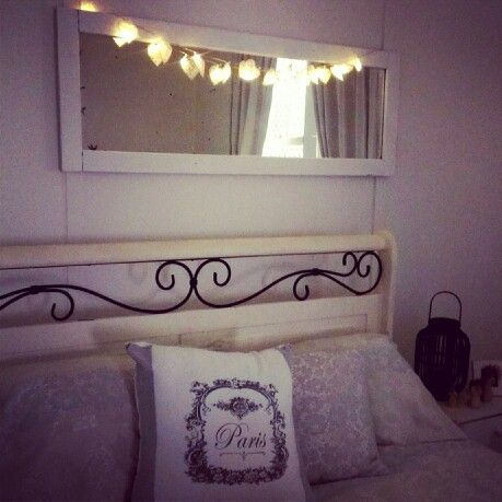 Heart lights on rustic mirror and wrought iron bedhead