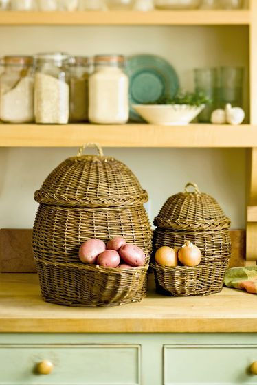 Potato and Onion Storage Baskets. //   Set of 2; large holds about 30 lbs. of potatoes, small holds about 6 lbs. of onions. Hand-woven willow with braided sea grass handles.