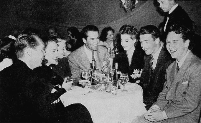 Jimmy Stewart and Burgess Meredith were close friends and even roommates circa 1940-41. Burgess staged a celebration at Mocambo in Hollywood for Jimmy after he returned home for a weekend leave from the war. This is a photo is from that party. Franchot Tone, Lorraine Gettman, Frances Ford Seymour, Henry Fonda, Betty Field and Burgess.