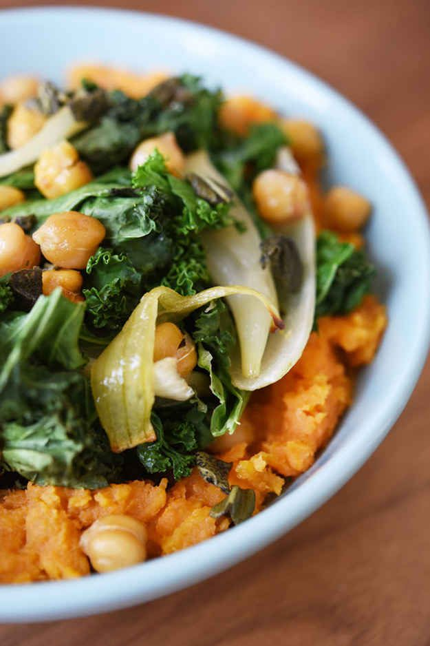 Roasted kale and chickpeas over mashed sweet potatoes.  Super easy, cheap, vegan dinner to make on a busy night