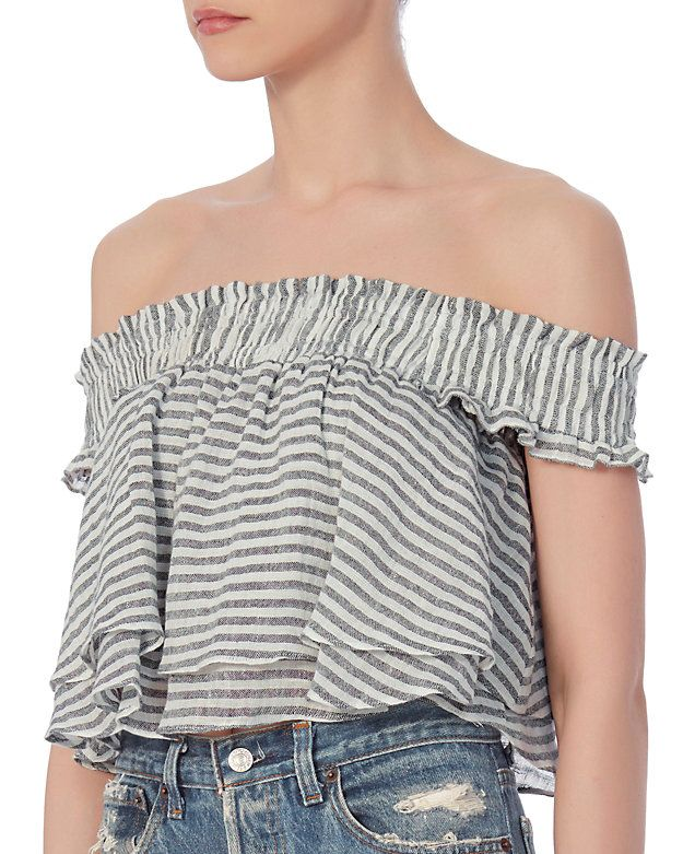 Apiece Apart EXCLUSIVE Striped Ruffle Top: A wide smocked elastic band keeps this top in place. Ruffled flare layered silhouette. Lined. In grey/white. Fabric: 95% linen/5% polyester Lining: 100% cotton Made in China.  Model Measurements: Height 5'10 1/2; Waist 24 ; Bust 31 wearing size 4 Length ...
