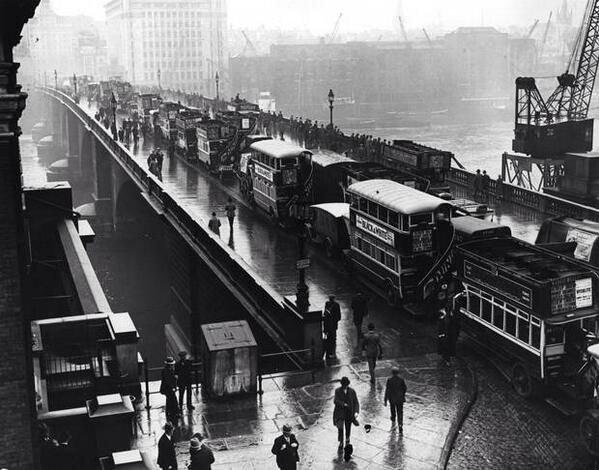 Passengers give up and walk as buses are gridlocked on London Bridge, August 1927. I know the feeling