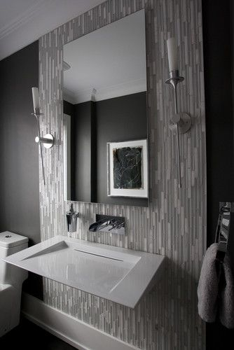 Powder Room - I like the floor to ceiling tiling to highlight the sink and mirror area.