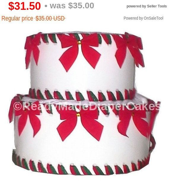 """This Christmas Themed Baby Shower Diaper Cake Centerpiece includes:  30-diapers of your choice  This comes in sizes:    2  Tier.   30-diapers.       8"""" tall.     Fits on a 10"""" tray 