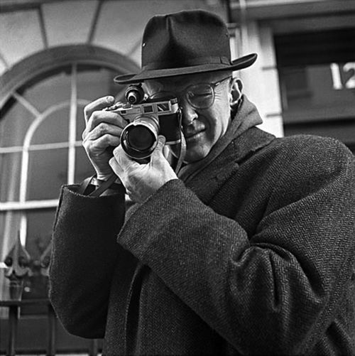"Henri Cartier-Bresson with Leica M3  Henri Cartier-Bresson (Aug 22 1908 – Aug 3 2004) was a French photographer considered to be the father of modern photojournalism. He was an early adopter of 35mm format, and the master of candid photography. He helped develop the ""street photography"" or ""real life reportage"" style that has influenced generations of photographers who followed.  On the Fondation Henri Cartier-Bresson website he is quotes as saying, ""To take"