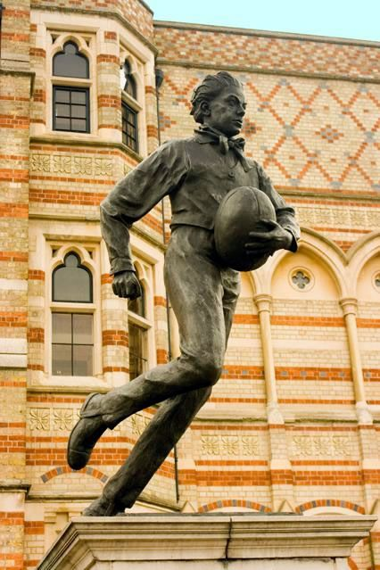 Webb Ellis statue outside Rugby School.