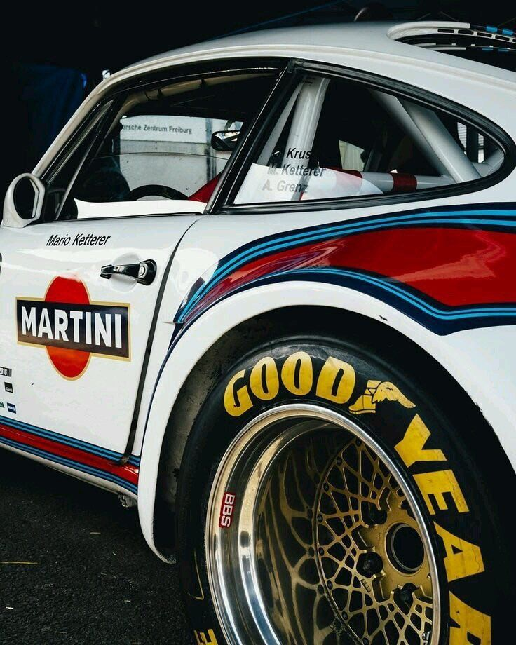 Porsche with Martini Branding and Goodyear tires