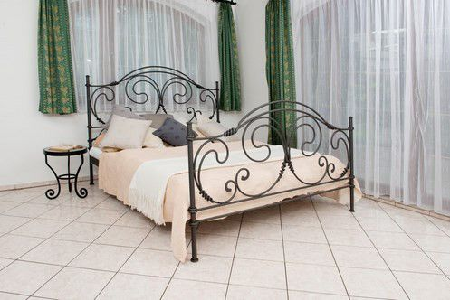 The Bianca bed is a stunning piece that combines Old World craftsmanship with modern styling. The scrollwork of this wrought iron piece brings to mind the graceful curves of a butterfly's wings with its arcs and flourishes. Available in a wide variety of colors, the Bianca reminds us of the beauty of nature and is the perfect way to add a contemporary flair to your decor while making the space feel homey and inviting.