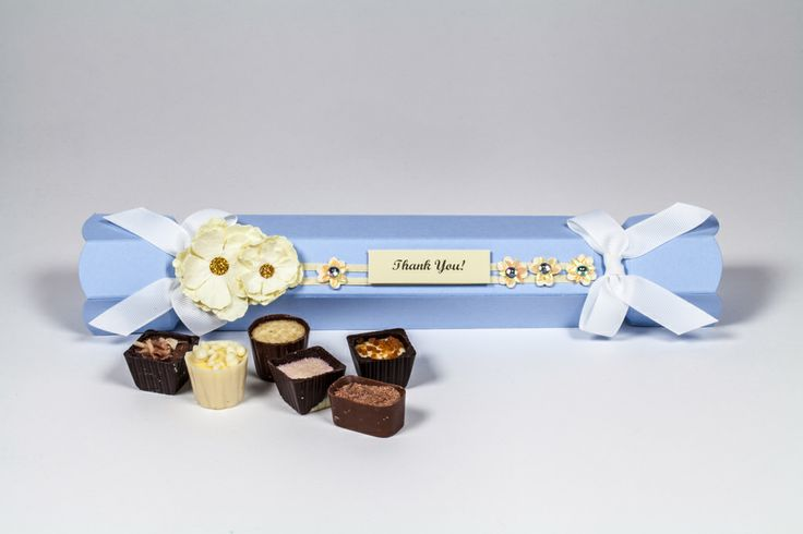 Pale blue celebration crackers with custom decoration. Perfect for chocolate and candy gift packaging. www.foldabox.co.uk