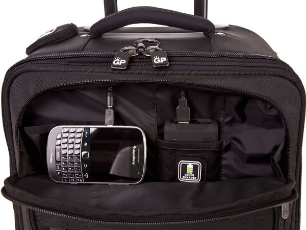This carry-on luggage from Genius Packer charges your phone! Never let it die in the airport ever again. That's a great feature!