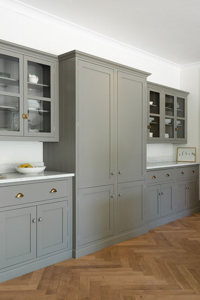 Herringbone floors, gray cabinetry | deVOL