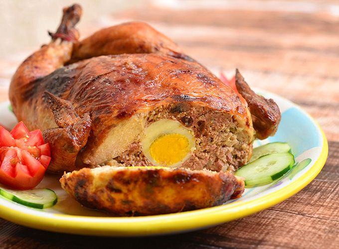 Rellenong manok is a deboned whole chicken stuffed with a meat mixture and then roasted until golden crisp