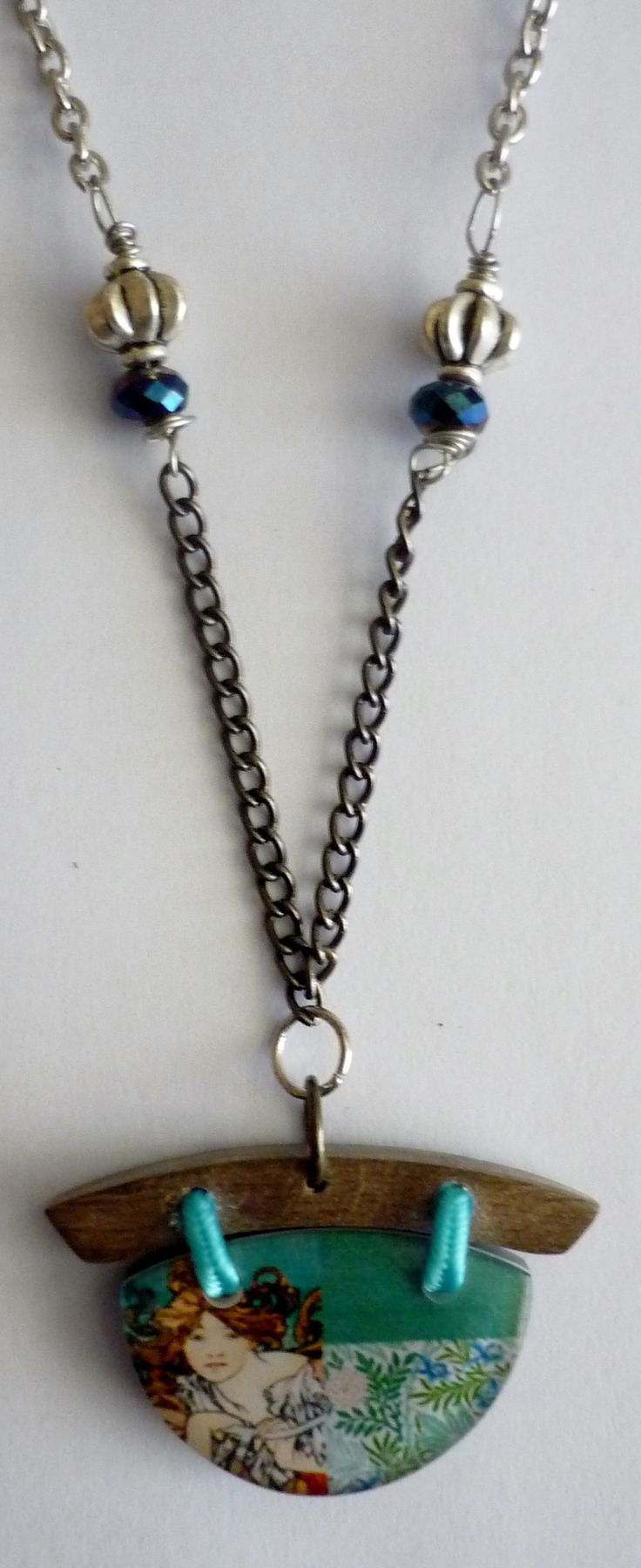 Amanda Harris Half-moon shape pendent with girl image on nickel/silver chain with silver turk caps and beads.