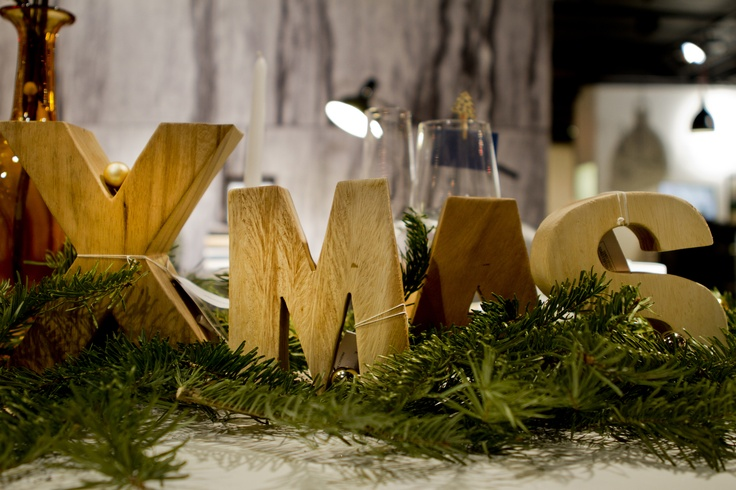 Place sculptural letters on your table and have  them say Christmas words like these wood letters from BoConcept.