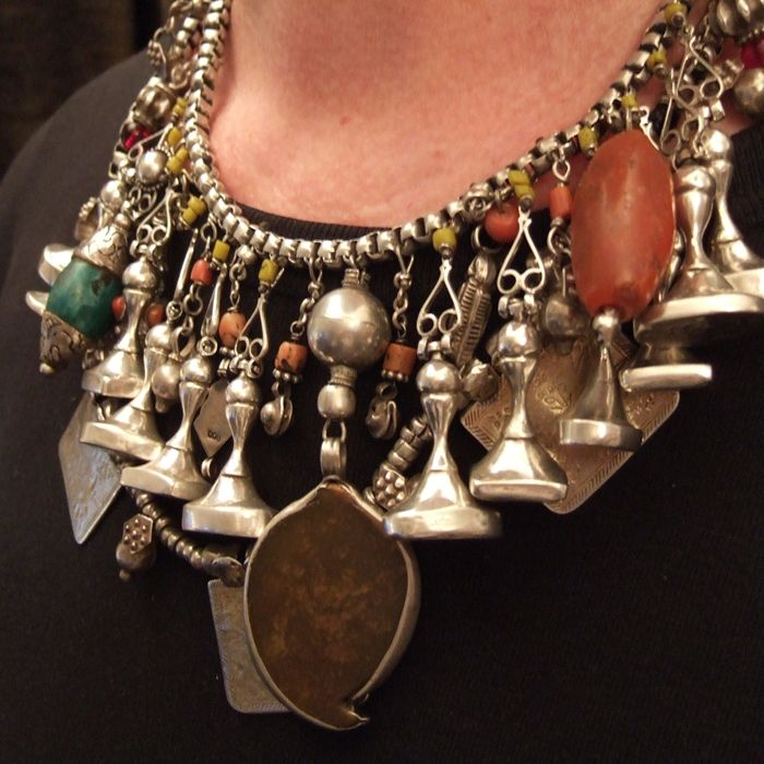 by Micheal Halter | Necklace created from a fantastic collection of ancient pendants and amulets collected by Michael | Double strand composing of 3 pendents with floral decorations coming from Morocco in brass and engraved silver, 12 Iranian sigillary silver seals, 3 elements from Asia (turquoise of Nepal, agate and carnelian of Afghanistan)…