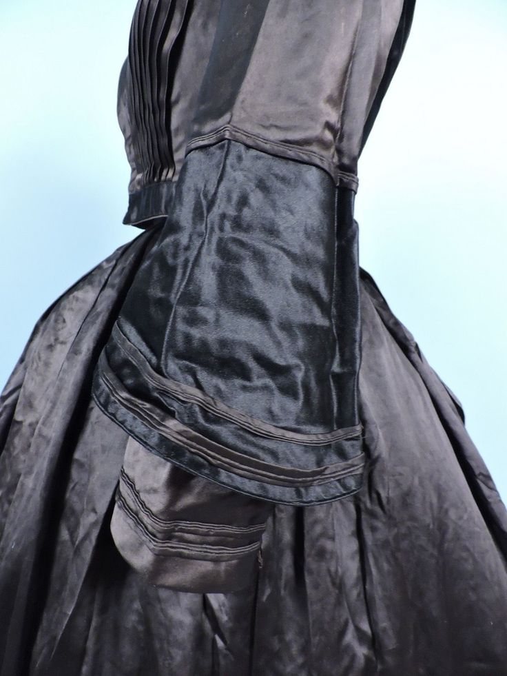 "C 1850 Black Chocolate Silk Satin Gown w Trumpet Sleeve ID | eBay seller jamiexmas*; two piece construction; hand sewn, fan pleated front, piping on sleeves; bodice lined with polished cotton; skirt no closure in rear; bust: 32""; bodice waist: 24""; skirt - waist: 26""; length: 40"" has note stating worn abt 1850, names? Sarah Jane Kigler Miller, note by Mary Millon McClung?"