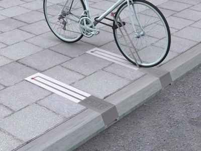 This unobtrusive bike rack takes up no space when there isn't a bike pinned to it.