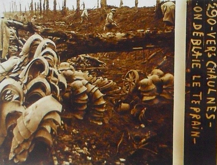 WWI, Chaulnes, bodyarmour and German helmets on the foreground. Source; picclick