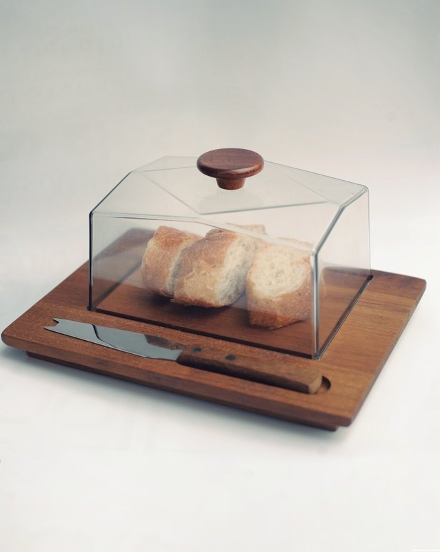 I need to figure out where to find one of these.  It's so cool!  I think this one's too small to fit a regular loaf of bread though.