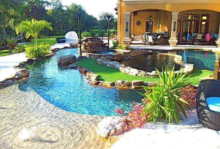 backyard oasis lazy river pool with island lagoon and jacuzzi in