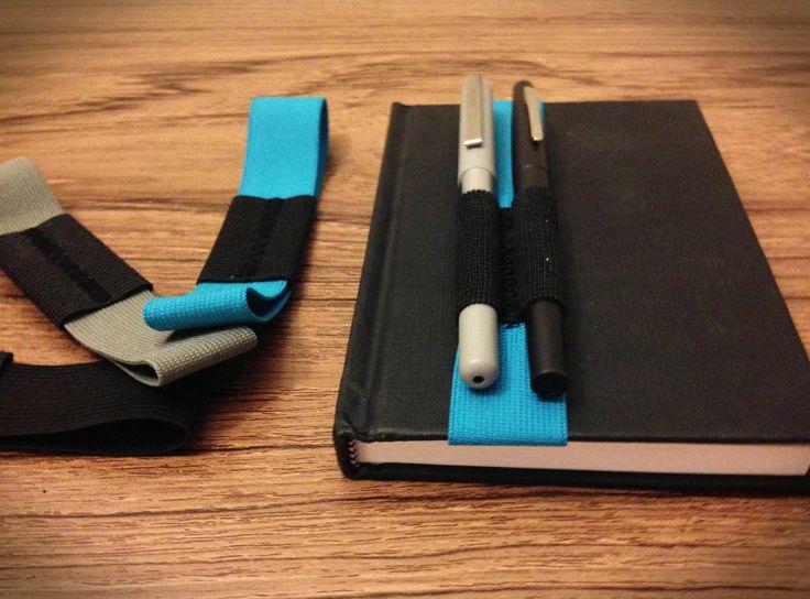 6-7 inch sketchbook or journal pen holder. $8.00, via Etsy.