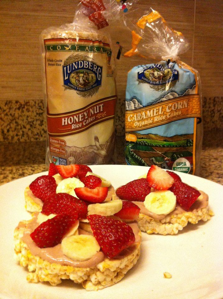 Organic rice cakes with a peanut or sun butter spread and fresh fruit on top. (Organic is important as many non-organic brands have extra added chemicals kiddos don't need in their bodies).