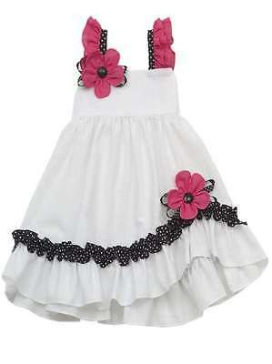 Adorable white, fuchsia and black seersucker sundress By Rare Editions! This dress a fuchsia rosette on the hem and the shoulder and is very comfortable for your little princess to play in.
