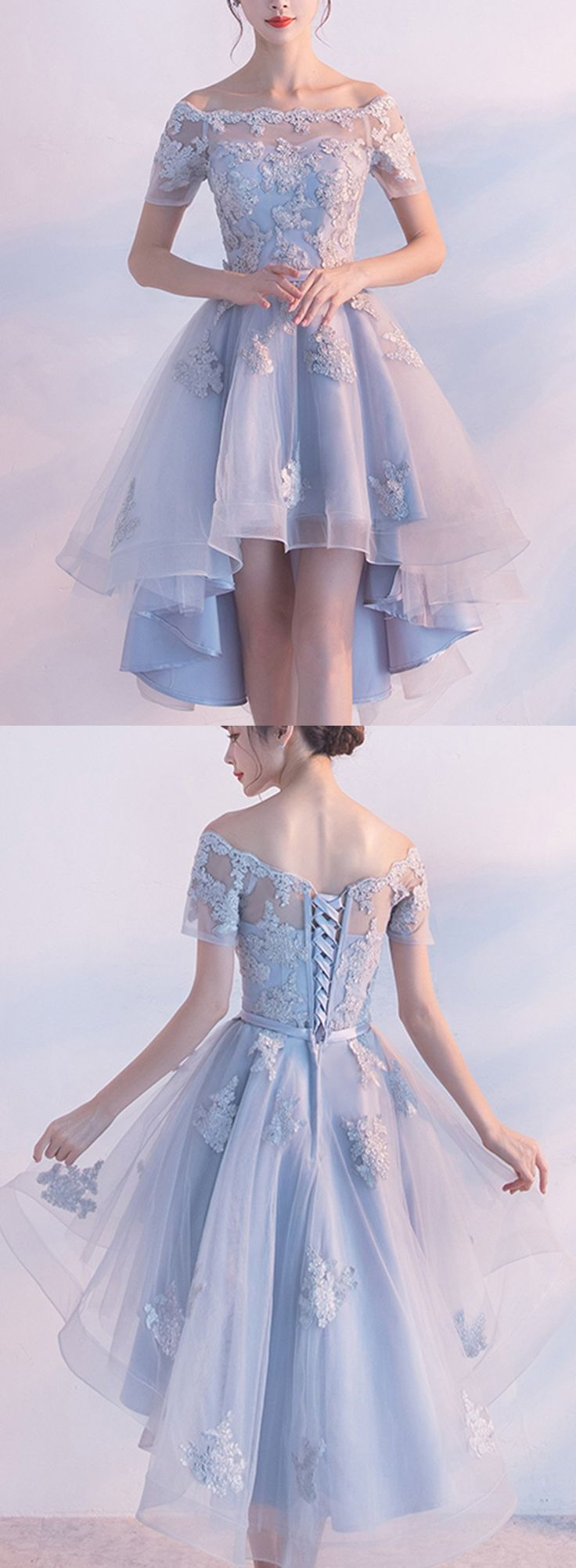 A lovely periwinkle-blue dress with a layered skirt and a lace-up back