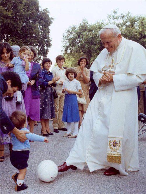 Pope John Paul II playing football with children