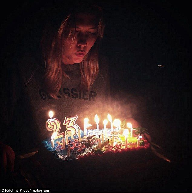Make a wish: Older sibling Kristine made sure to document the model blowing out her candle...
