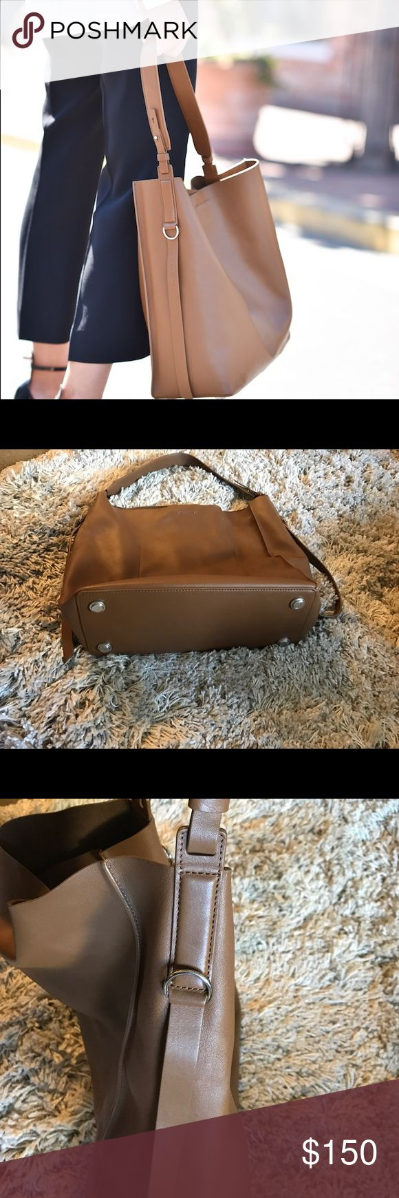 Original Allsaints leather tote This is a great leather tote bag in great conditions, look like new. The color is similar to Camel. There is an small punch like a cosmetic bag. 💯 leather. allsaints Bags Totes