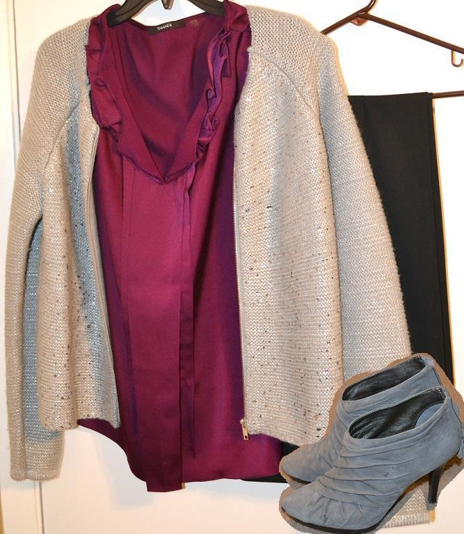 A deep fascia blouse with a metallic sweater paired with plain black slacks and grey ruched booties